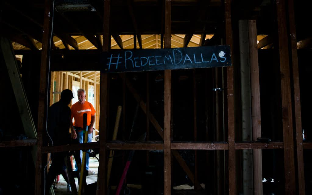 Job foreman Byron Rose (left) and project manager Martin Evans of 2ndSaturday's 2S Industries program walk around a house in Oak Cliff. Rose was convicted of aggravated robbery and served time in prison before finding a job with 2S Industries. (Ashley Landis/The Dallas Morning News)