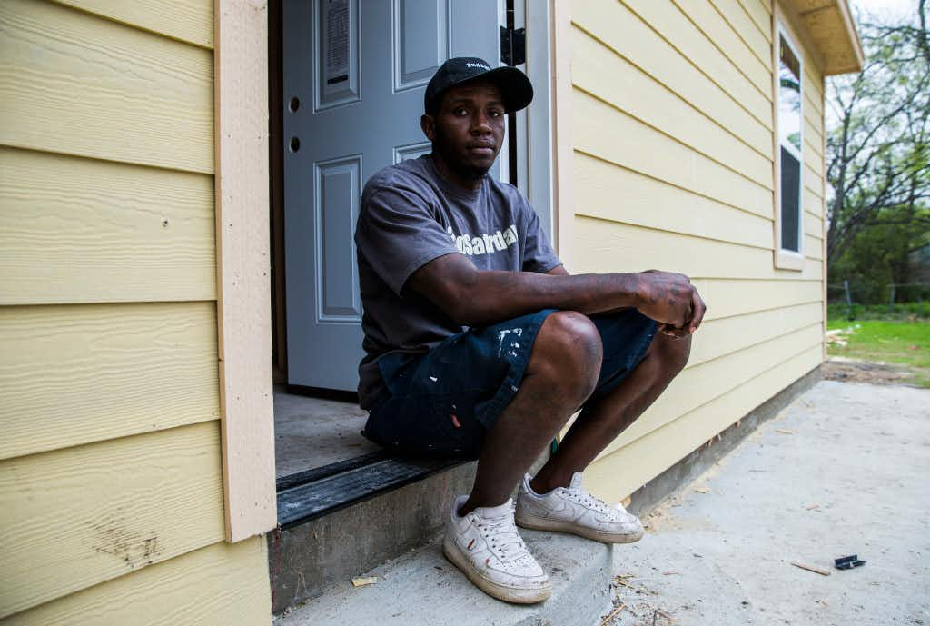 "<p>Byron Rose, job foreman for 2ndSaturday's 2S Industries program, sits outside an Oak Cliff home he's helping to rebuild. ""I wake up in the morning and I get to go to work — I don't have to go to work, I want to go to work,"" the 32-year-old Dallasite says. (Ashley Landis/The Dallas Morning News)</p>"