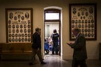 Members of the Texas-based group Mothers Advocating for Medical Marijuana for Autism wait in a side room for a meeting with the staff of Sen. Dawn Buckingham at the Texas Capitol on March 15 in Austin. (Smiley N. Pool/The Dallas Morning News)