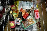 Asian ingredients in a cart at Jusgo Supermarket in Plano  (Rose Baca/Staff Photographer)