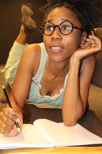 Kimberly Nichole plays Iris in <i>Jar Fly</i>, the first one-act piece in <i>The Trinity River Plays</i>, presented by Soul Rep Theatre Company at South Dallas Cultural Center through April 2.((Anyika McMillan-Herod))