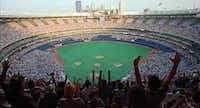 Fans in sold out Three Rivers Stadium cheer on the Pittsburgh Pirates against the St. Louis Cardinals in 1998. The stadium is an example of the cookie-cutter style of multipurpose stadium construction, one in which many stadiums lost their unique character.(AP file photo)