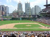 Pittsburgh's retro-style PNC Park sits across the Allegheny River from downtown. The river is 443 feet from home plate, and some fans arrive at the game by boat.  The view is widely regarded as the best in baseball.(DigitalBallparks.com)