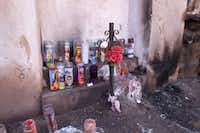 Candles are scattered around a small but fascinating shrine in downtown Tucson. (Jim Byers/Special Contributor)