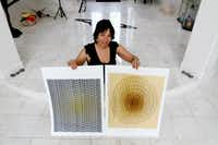 Artist Orna Feinstein, at her home in Bellaire, works with an etching press to create multidimensional commissions in her studio a mile from home. (Andy Jacobsohn/The Dallas Morning News)