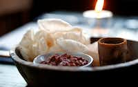 Shrimp chicharrones with salsa rojo and a cup of mescal at the Capri (Guy Reynolds/The Dallas Morning News)(Staff Photographer)
