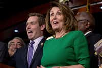 House Minority Leader Nancy Pelosi of California, accompanied by Reps. G. K. Butterfield, D-N.C.,and Rep. Eric Swalwell, D-Calif., joked at a news conference on Capitol Hill in Washington on Friday after Republican leaders abruptly pulled their troubled health care overhaul bill off the House floor. (Andrew Harnik/The Associated Press)