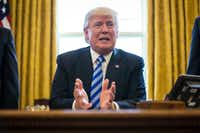 "President Donald Trump speaks about the House pulling its planned legislation to repeal the Affordable Care Act in the Oval Office of the White House in Washington on Friday. Trump, in a telephone interview moments after the bill was pulled, blamed Democrats and predicted that they would seek a deal within a year, he asserted, after ""Obamacare explodes"" because of high premiums. (Al Drago/The New York Times)"