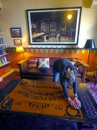 At the haunted Hotel Congress in Tucson, a Ouija board table provides visitors with a possible way to contact the other side.((Paul Ross))