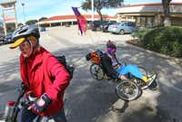 Jeffrey Weiss, right, maneuvers his recumbent tricycle as his wife Marni gets set to ride with him on her bicycle as they run errands in February.&nbsp;<div><br></div>(Louis DeLuca/Staff Photographer)