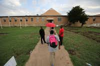 <p>Students going to class at Prime Prep's Dallas campus. (Nathan Hunsinger/The Dallas Morning News)</p>
