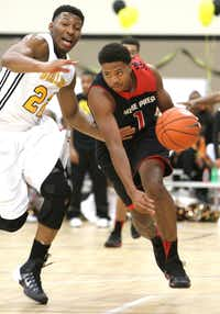<p>Prime Prep's Devonte' Bailey (1) drives past the defense of Triple A Academy's King McClure (22) in November 2013. (Steve Hamm/Special Contributor)</p>