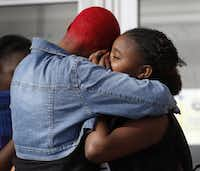 <p>Twanna Washington (left) comforts her daughter Terrianna Washington, 13, a sixth grader, as she gets out of class at Prime Prep Academy for the last time in Fort Worth. (Rose Baca/The Dallas Morning News)</p>