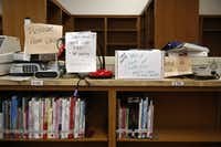 Broken equipment and empty book shelves in the library at Thomas A. Edison Middle Learning Center in Dallas on Oct. 15, 2015.  (Rose Baca/The Dallas Morning News)(Staff Photographer)