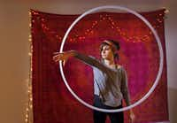 "Tara Hughes demonstrates ""hoop dancing,"" at her home in Argyle in February, 2014.(Kye R. Lee/Staff Photographer)"