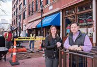 Jennifer Sanders, left, and Trey Bowles, co-founders of the Dallas Innovation Alliance, stand near where the first smart city kiosk is being installed in the West End.(Rex C. Curry/Special Contributor)