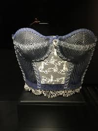 "Susan Taylor Glasgow's glass corsets on display at Hotel Murano  have ""embroidery"" that reveals engravings of women doing housework. (Sharon McDonnell)"