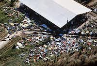 Dead bodies lie around the compound of the Peoples Temple cult on Nov. 18, 1978 after more than 900 members of the cult, led by the Rev. Jim Jones, died from drinking cyanide-laced punch. (David Hume Kennerly/Getty Images)