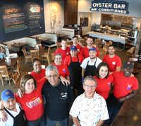 Bill Bayne of Fish City Grill poses with the crew of the restaurant located at 1415 East Renner Road in Richardson, Texas.  (Louis DeLuca/The Dallas Morning News)(Staff Photographer)
