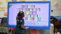 A student at Harllee Early Childhood Center interacts with educational software on a touchscreen computer on Tuesday March 28, 2017.(Dom DiFurio/Staff)