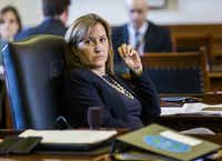 Sen. Konni Burton, R-Colleyville, listens to discussions on open carry legislation during the final days of the 84th Texas legislature regular session on Friday, May 29, 2015 at the Texas state Capitol in Austin.  (Ashley Landis/The Dallas Morning News)