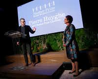 Huyghe accepted the award from Nancy Nasher at Saturday night's gala. He was the second recipient of the award. (Tom Fox/Staff Photographer)