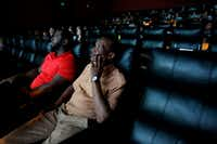 Exonerees Johnnie Lindsey (right) and Christopher Scott watch a screening of <i>True Conviction</i>, a documentary film by Jamie Meltzer that features the men, at Alamo Drafthouse in Dallas. (Rose Baca/The Dallas Morning News)