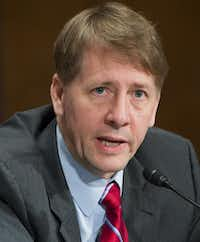 <p>Richard Cordray was appointed director of the Consumer Financial Protection Bureau in January 2012. The bureau is credited with returning $12 billion to more than 29 million consumers due to fraudulent financial deals. (File photo, 2016/Getty Images)</p>