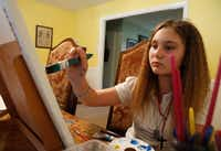 Alexis Brown concentrates on a painting in her Denison home. Art helps her focus and to better handle her medical issues, which include four heart surgeries.<div><br></div>((Ron Baselice/Staff Photographer))