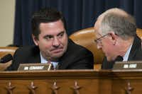 Embattled California Rep. Devin Nunes confers with Rep. Mike Conaway of Midland. (Drew Angerer/Getty Images)
