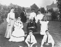 <p>G.B. Dealey and his wife Olivia (seated, left), with their children and two household employees. Clockwise from top are&nbsp;Josh and Viola McCree; and the Dealey children Fannie, Maidie, Walter, Edward (Ted), and Annie.&nbsp;This photo was taken around 1901.</p>