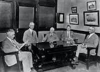 Directors of A. H. Belo &amp; Co. (from left) Tom Finty Jr., John F. Lubben, G.B. Dealey, Walter A. Dealey and Ennis Cargill convene a session in the office of G.B. Dealey on Sept. 22, 1925, just prior to the 40th anniversary of <i>The Dallas Morning News</i>. A year later, G.B. Dealey bought a majority interest in A. H. Belo &amp; Co.
