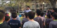 Adan Gonzalez, the executive director of the Puente Network in Dallas, talks to soccer players in Lake Cliff Park on March 16, 2017. (Adan Gonzalez.)