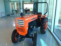 An example of the first Kubota Tractor model sold int the U.S. in 1972 - the L 200 - sits in the lobby of the company's new Grapevine headquarters.(Steve Brown)