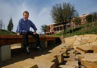 Landscape architect Michael Van Valkenburgh is photographed on a wooden walkway that stretches across a watershed area of the George W. Bush Presidential Center in this 2013 file photo. (Tom Fox/The Dallas Morning News)