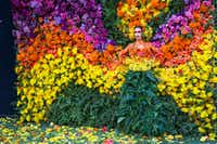 A model poses in the floral wall at the Eye Ball party. The memorable event design was produced by Swoon the Studio, GRO Designs and Planet Productions. (Ron Heflin/Special Contributor)