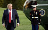 U.S. President Donald Trump walks on the south lawn on Sunday, April 9, 2017 after arriving at the White House in Washington, D.C. (Olivier Douliery/Abaca Press/TNS)