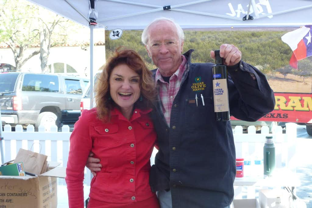Texas Olive Ranch owner and farmer Jim Henry with Georgann Rosamund. White Rock Soap Gallery, in the tent next to his at Local, uses his olive oil in some of its soaps. (Kim Pierce)