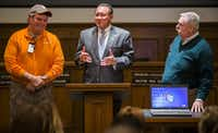 Rowlett Mayor Todd Gottel honors Rowlett residents Sammy Walker (left) and Bruce Hargrave for helping a neighbor who was severely injured during the December 2015 tornado.  (Ashley Landis/The Dallas Morning News)
