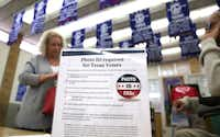 A sign tells voters of voter ID requirements before participating in the primary election at Sherrod Elementary school in Arlington, Texas.(2016 File Photo/The Associated Press)