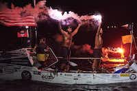 After their history-making row across the Atlantic Ocean, the team members fired flares in celebration as they reached Nelson's Dockyard English Harbor, about 300 miles east of Puerto Rico. From left are Matson, Krauskopf and Alviar.((Ben Duffy))