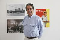 John Cuellar poses with a photo of his father -- and the Oak Cliff El Chico that would eventually become El Corazon (Ben Torres/Special contributor)(Special Contributor)