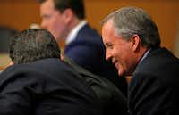 Texas Attorney General Ken Paxton (right) smiles during his pretrial hearing at Collin County Courthouse in McKinney on Feb. 16. (Jae S. Lee/The Dallas Morning News)