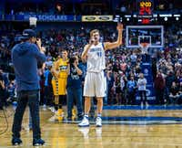 Dallas Mavericks forward Dirk Nowitzki says a few words before the game against the Denver Nuggets on Tuesday at the American Airlines Center. (Ashley Landis/The Dallas Morning News)