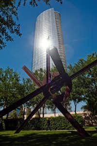 Museum Tower, which was backed by Dallas' pension fund, reflects a glaring light into the garden around a sculpture at the Nasher Sculpture Center in Dallas, Texas, April 18, 2012. The city's pension fund for police and firefighters is near collapse and is seeking an immense bailout, a request that threatens to push the city into bankruptcy. (Brandon Thibodeaux/The New York Times)