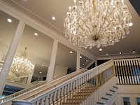 This staircase at The Guest House at Graceland is modeled after one at Graceland that leads to a private area of the house. The chandelier was designed for Graceland but was deemed too large, so it sat in storage until the resort was built. It's designed as a photo op for visitors.