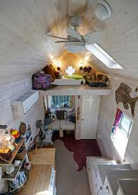 Demere O'Dell's tiny house has a bedroom loft.  There's even a tiny ceiling fan.  (Jae S. Lee/Staff Photographer)
