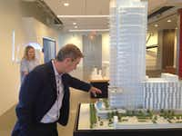 Developer Craig Hall explains a model of his Hall Arts Residences and Hotel project in downtown Dallas.(Steve Brown)