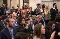 Exchanges between April Ryan (second row, second from left) and the Trump administration have sparked debate about White House attitudes toward race and gender. (Stephen Crowley/The New York Times)