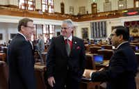 "<p><span style=""font-size: 1em; background-color: transparent;"">Rep. Dan Huberty (center), R-Houston, conferred with Rep. Byron Cook (left), R-Corsicana, and Rep. Diego Bernal, D-San Antonio, on the House floor before Huberty's bill to add money to most public schools came up for debate Wednesday. (Eric Gay/The Associated Press)</span></p>"
